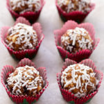 Overhead view of Cranberry Coconut Energy Balls on a neutral background.