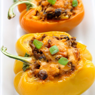 This easy Mexican Stuffed Peppers recipe is made with beef, rice, vegetables and cheese. It makes a spicy, healthy meal that is also gluten-free!