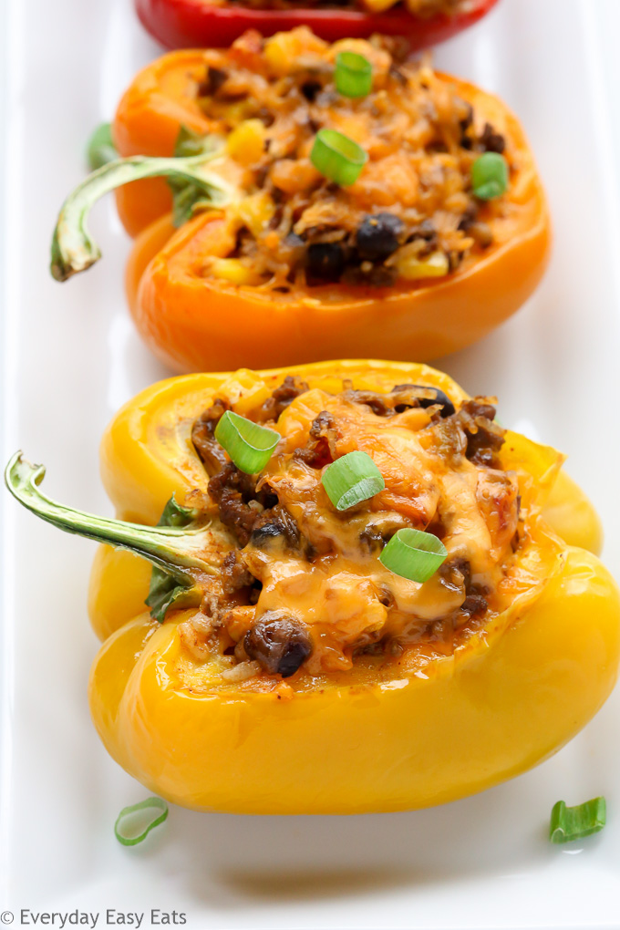 Close-up side view of Mexican Stuffed Peppers in a white serving dish.