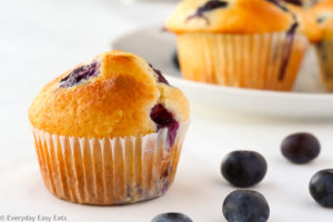 The ultimate go-to recipe for blueberry muffins. These fluffy baked treats are buttery, moist, and loaded with juicy blueberries. | EverydayEasyEats.com