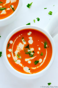 This rich, smooth Cream of Tomato Soup packs tons of flavor in each spoonful. Serve on its own or with a sandwich or salad for a satisfying meal. | EverydayEasyEats.com