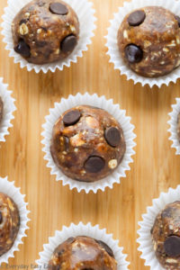 Close-up overhead view of Peanut Butter Energy Balls on a wooden background.
