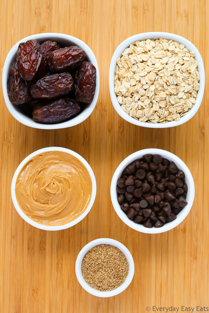 Overhead view of ingredients for Peanut Butter Energy Balls on a wooden background.