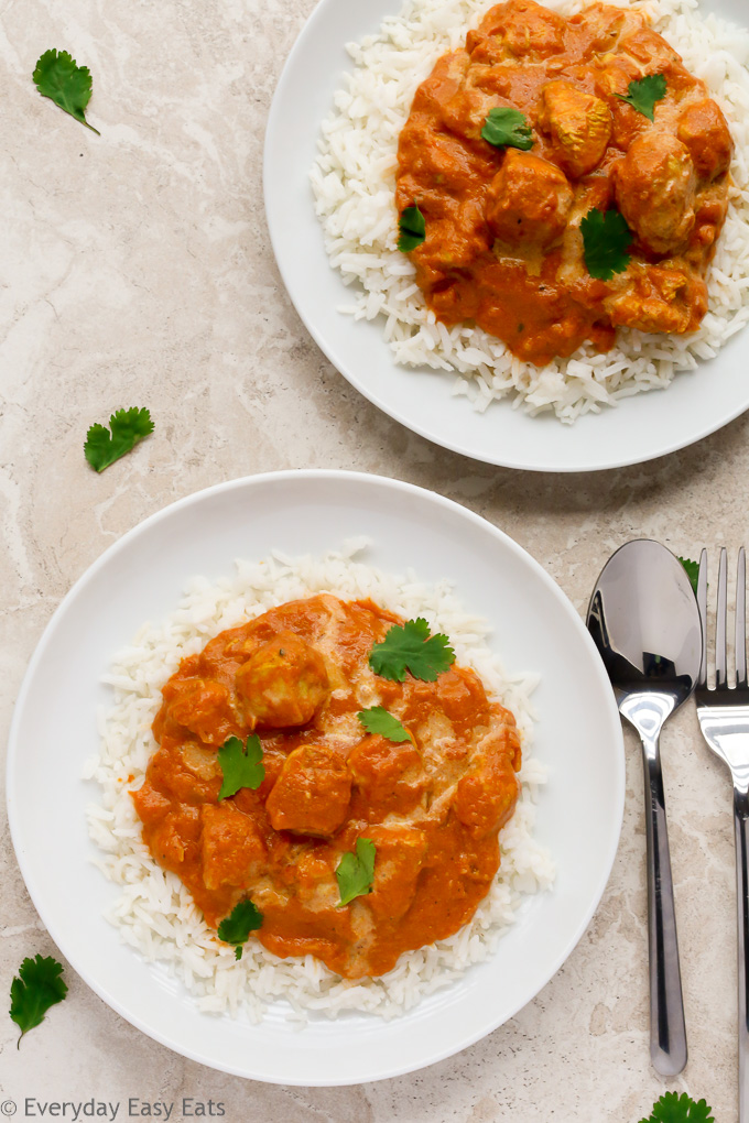 Overhead view of two plates of Quick Indian Chicken Curry over white rice.