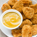 Baked Chicken Nuggets with Honey Mustard Sauce | EverydayEasyEats.com