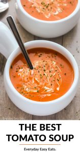 Overhead view of Creamy Tomato Soup in a white bowl on a wooden background with title text overlay.