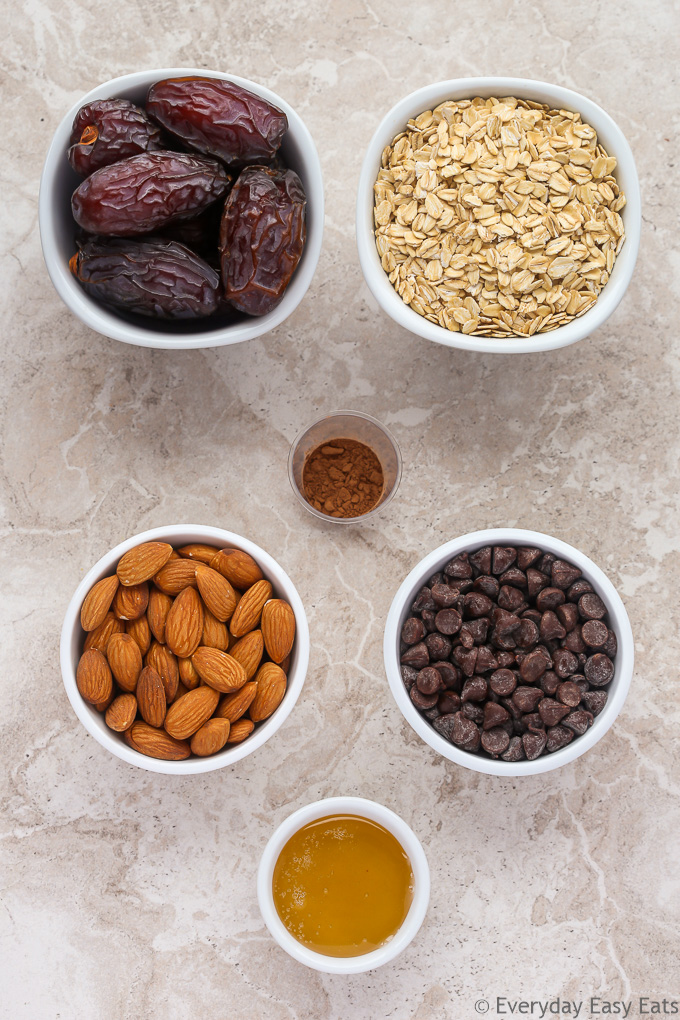 Overhead view of ingredients for Chocolate Chip Granola Bars on a neutral background.
