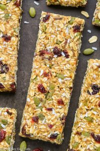 Close-up overhead view of No-Bake Healthy Nut-Free Granola Bars on a dark background.