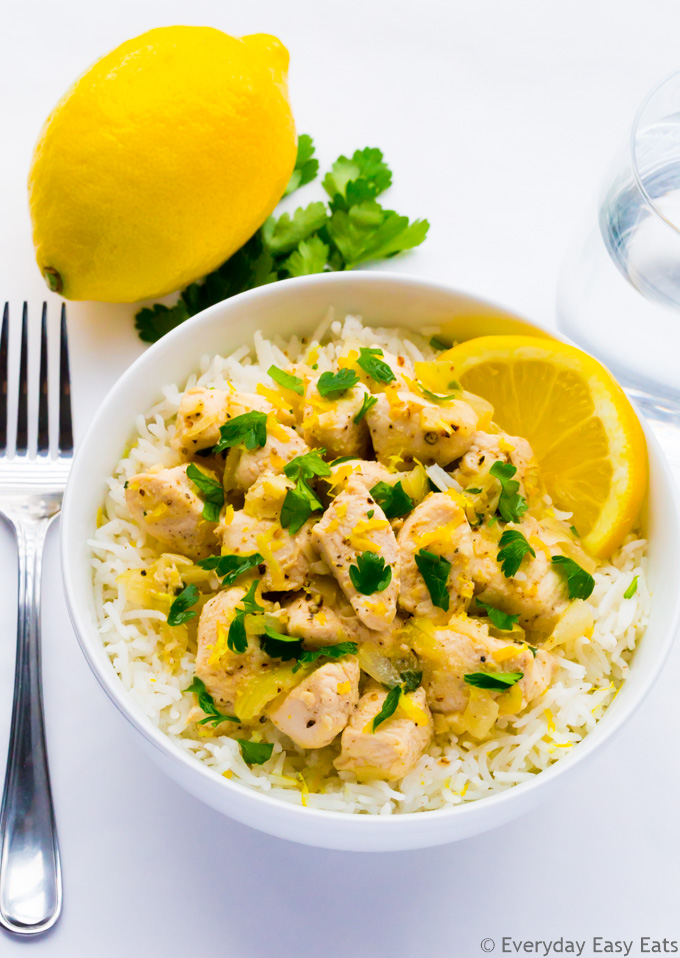 Overhead view of Chicken Scampi in a white bowl on a white background