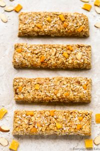 Overhead view of Healthy Mango Coconut Granola Bars on a neutral background.