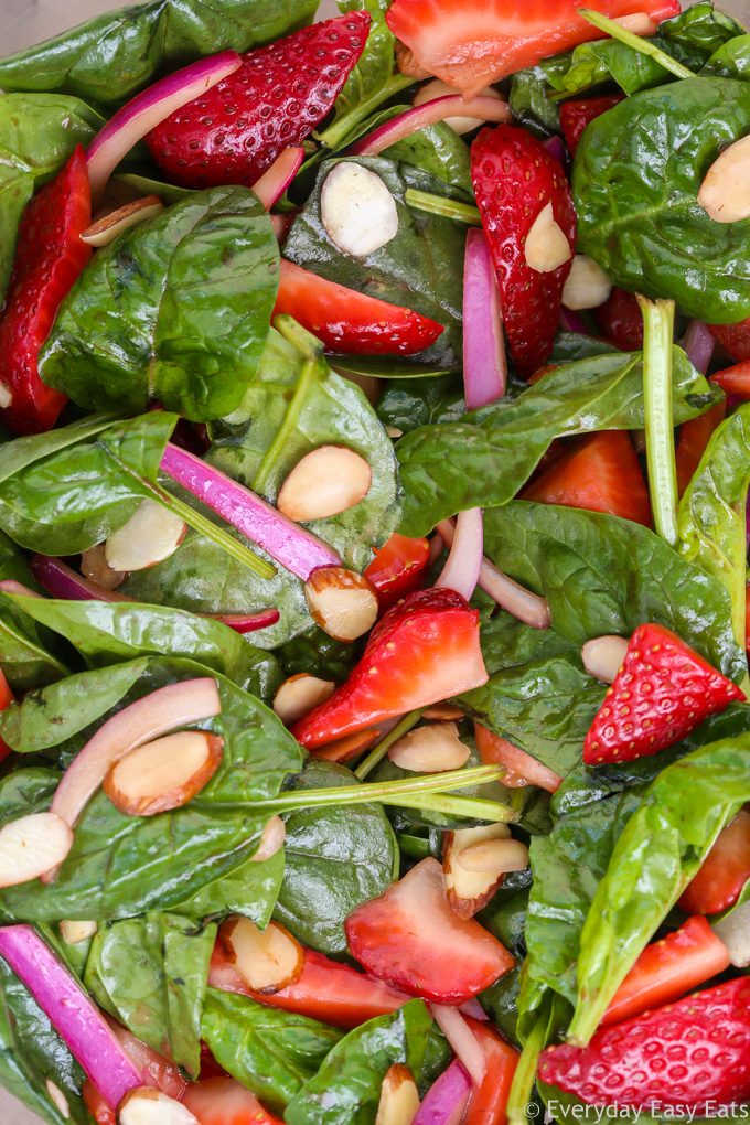 Very close-up view of Strawberry Spinach Salad with Balsamic Dressing