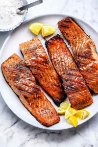 Overhead view of Grilled Salmon on a white plate.