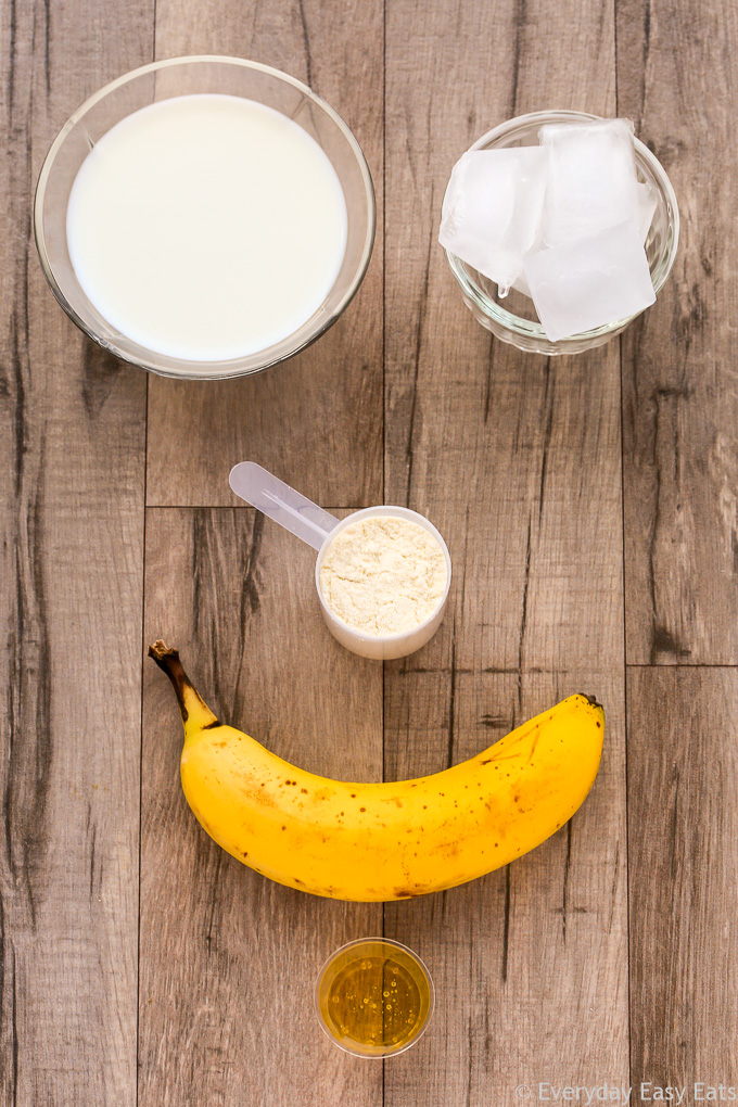 Overhead view of Banana Protein Shake ingredients on a wooden background.