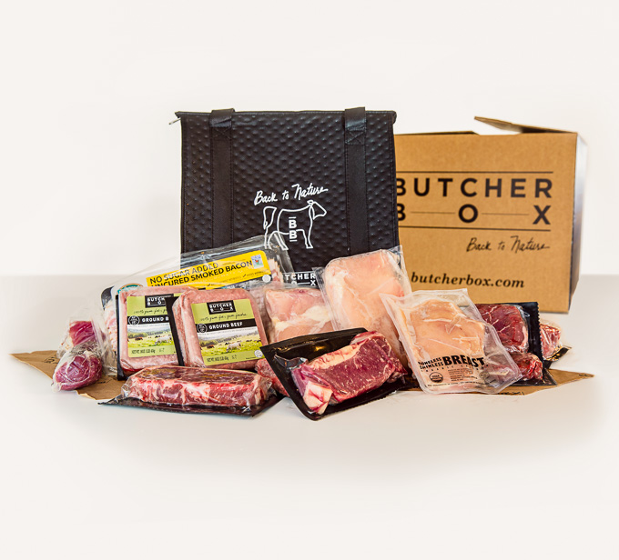 ButcherBox Review: Side view of ButcherBox with packages of grass-fed, organic meat on white background