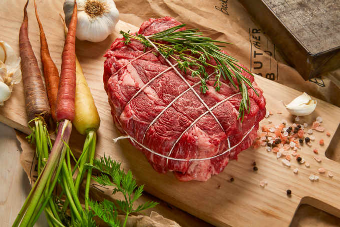 ButcherBox Review: Overhead view of organic, grass-fed chuck roast on wooden background