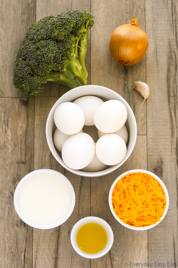Overhead view of Broccoli Frittata ingredients on a wooden background.