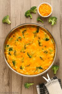 Overhead view of Broccoli Frittata in a skillet on a wooden background.