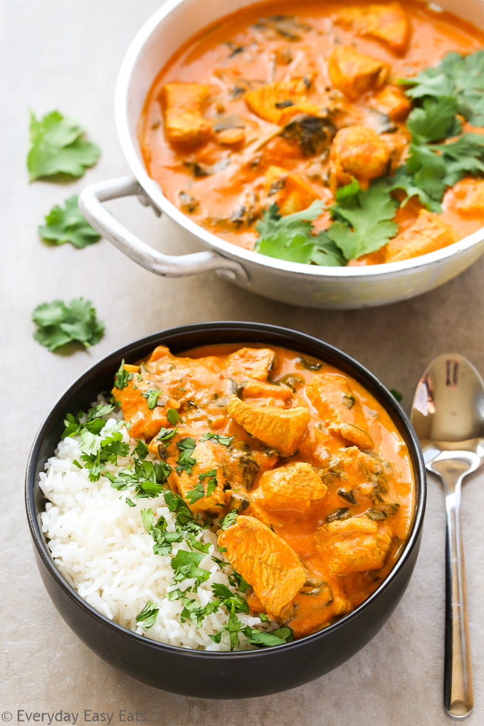 The Best Organic Food & Grocery Delivery Services: Overhead view of Indian Coconut Chicken Curry with white rice in a bowl with a spoon on the side.