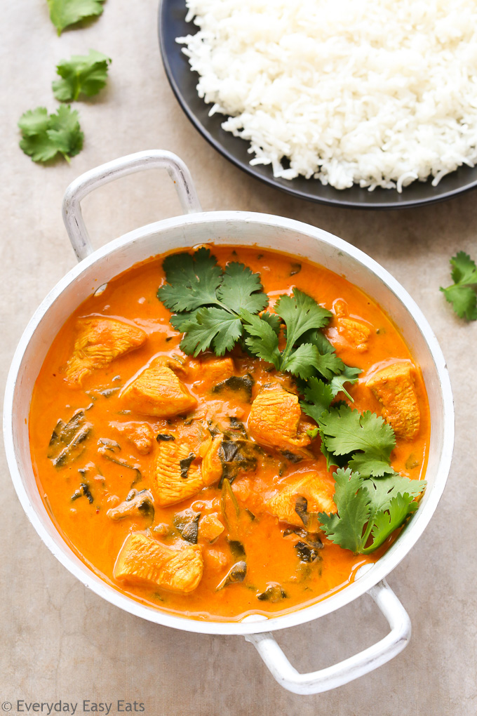 Overhead view of Indian Coconut Chicken Curry in a silver serving dish.
