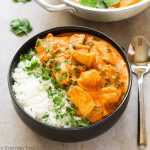 Overhead view of Indian Coconut Chicken Curry in a bowl with title text overlay.