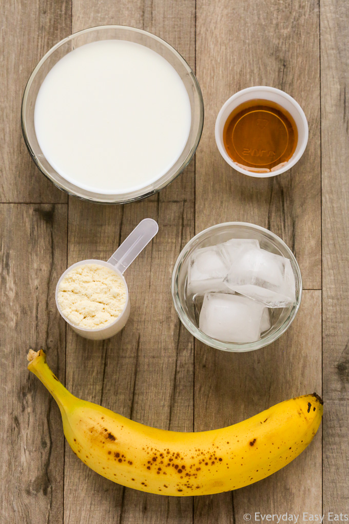 Overhead view of ingredients required to make a Vegan Protein Shake on a wooden background.