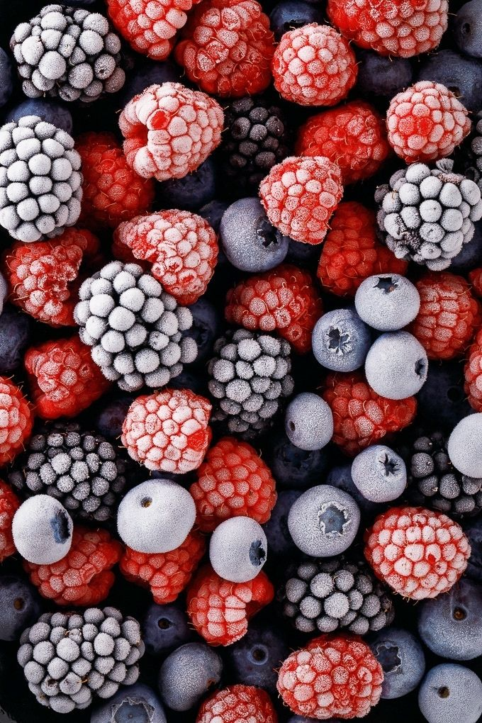 Close-up overhead view of frozen mixed berries.